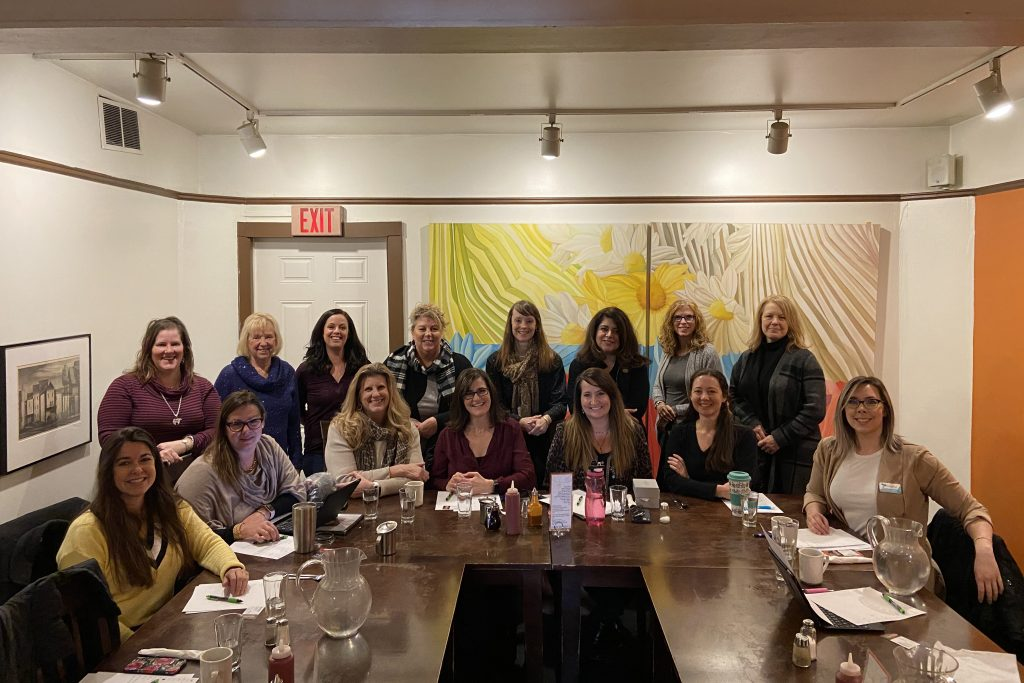 Team Women members meet to network and socialize at The Daisy Cafe & Cupcakery in Madison, Wisconsin.